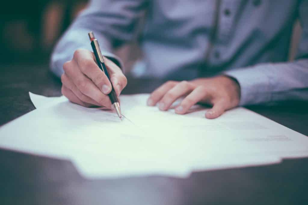 Signing papers to gain a reverse mortgage