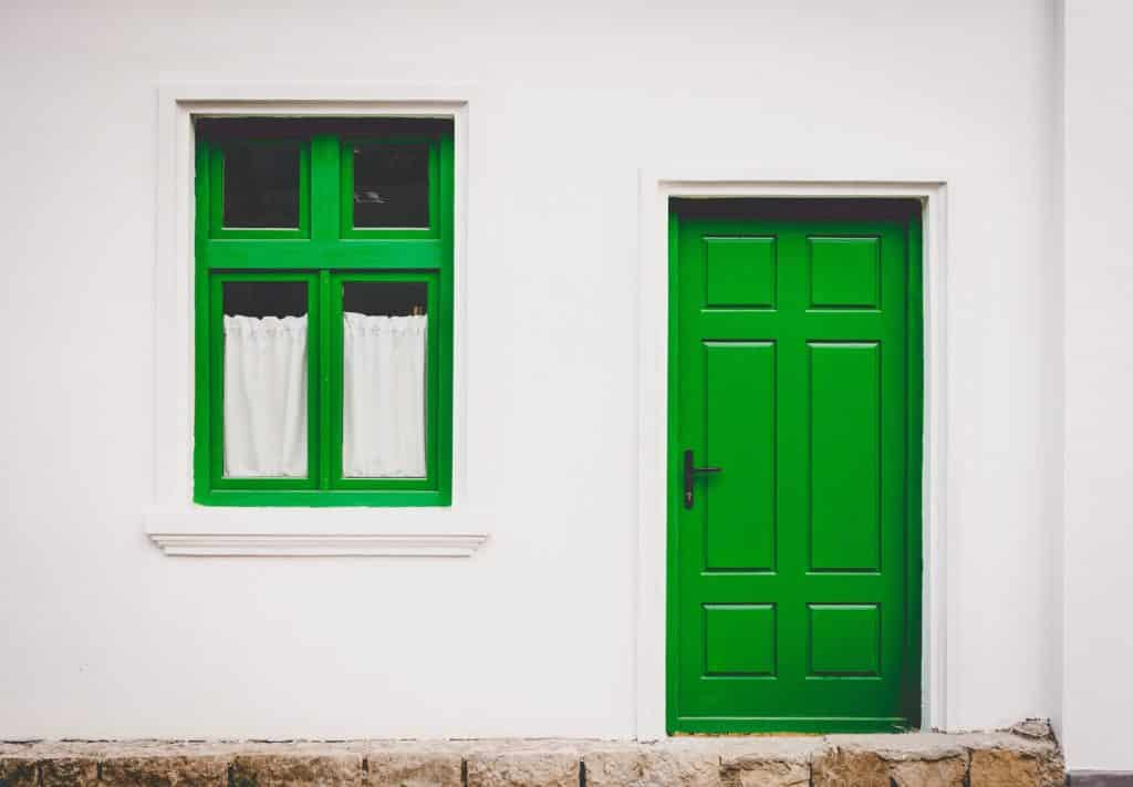 A lime green front door and a lime green window.