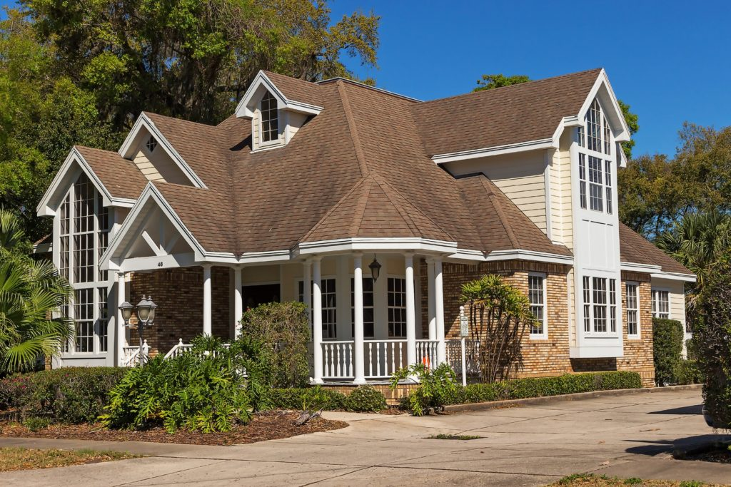 A two-story home with a curved porch.