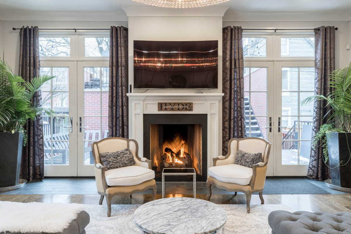 High-end furniture and a fireplace in a well-designed living room.